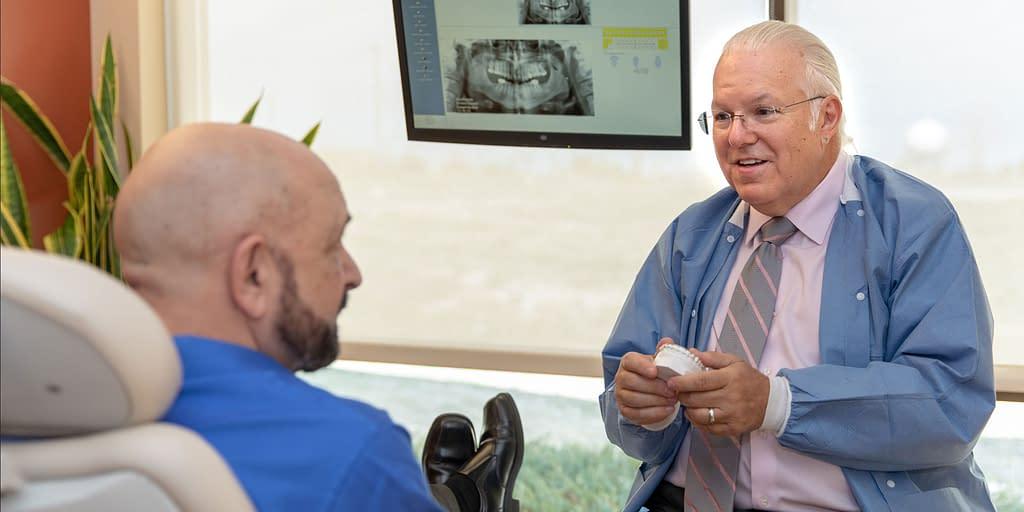dr chris harvan discussing tmj treatment