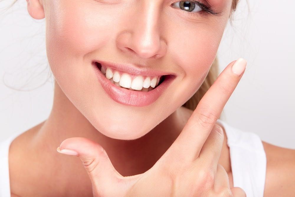 A woman highlighting her teeth & gums