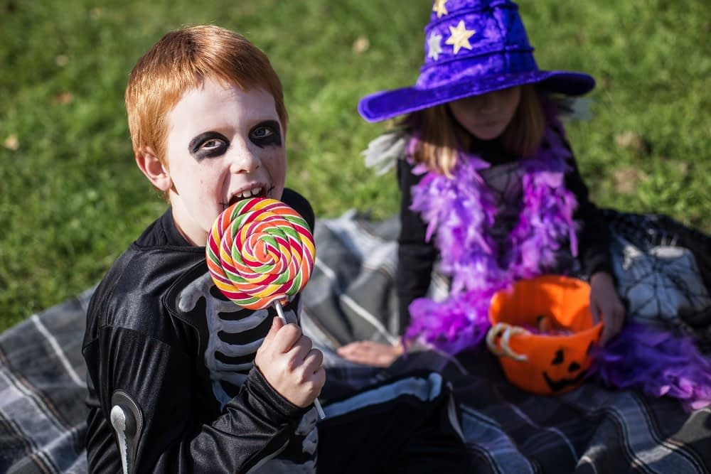 Kids eating candy in a Halloween candy