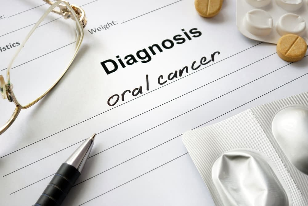 A paper that says: Diagnosis? Oral Cancer.