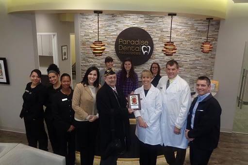 Paradise Dental Staff receiving a plaque of Appreciation from the Salem Veterans Council
