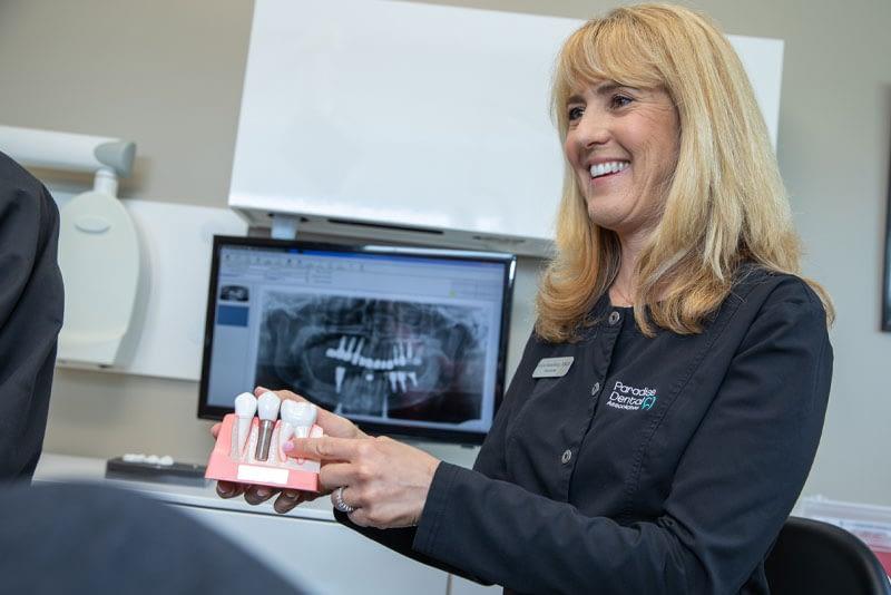 dr helyne hamelburg discussing dental implants procedure
