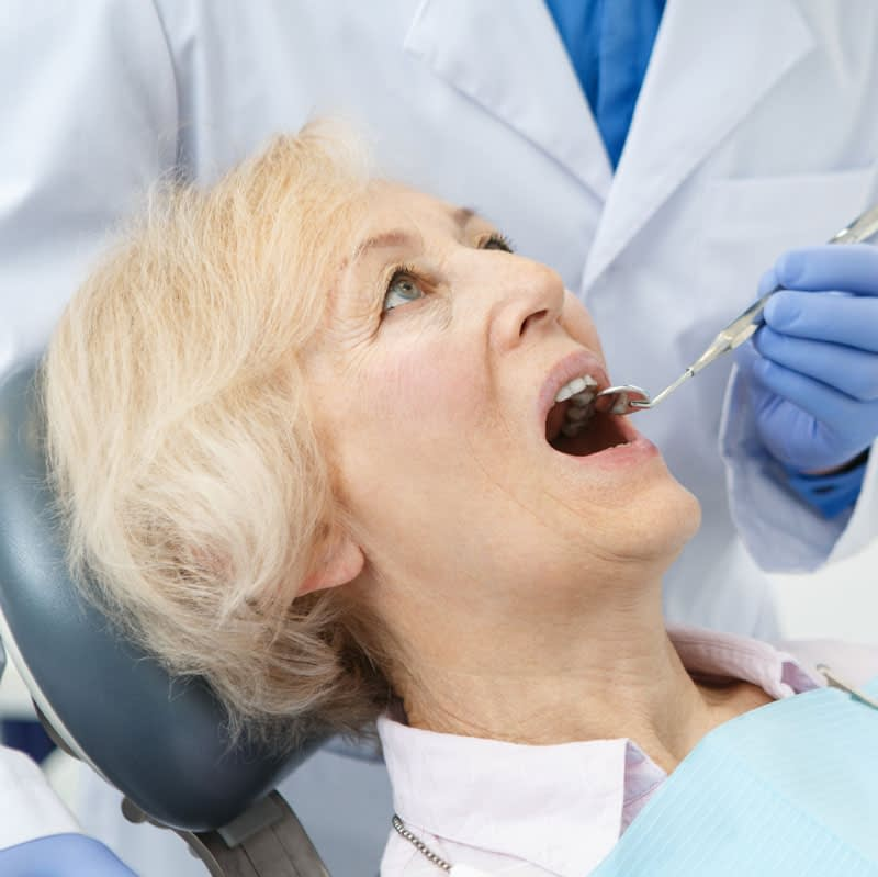 dental-patient-undergoing-pathology-exam