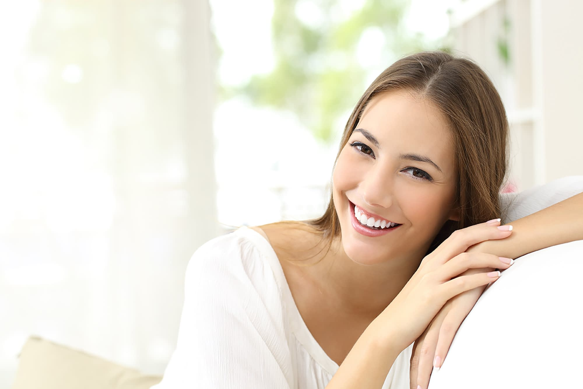 Lady smiling after Soft tissue re-contouring treatment Brownstown, MI
