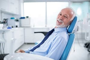 a dental patient smiling after his treatment with sedation