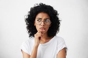 Dental Patient Questioning About Dental Implant Procedures