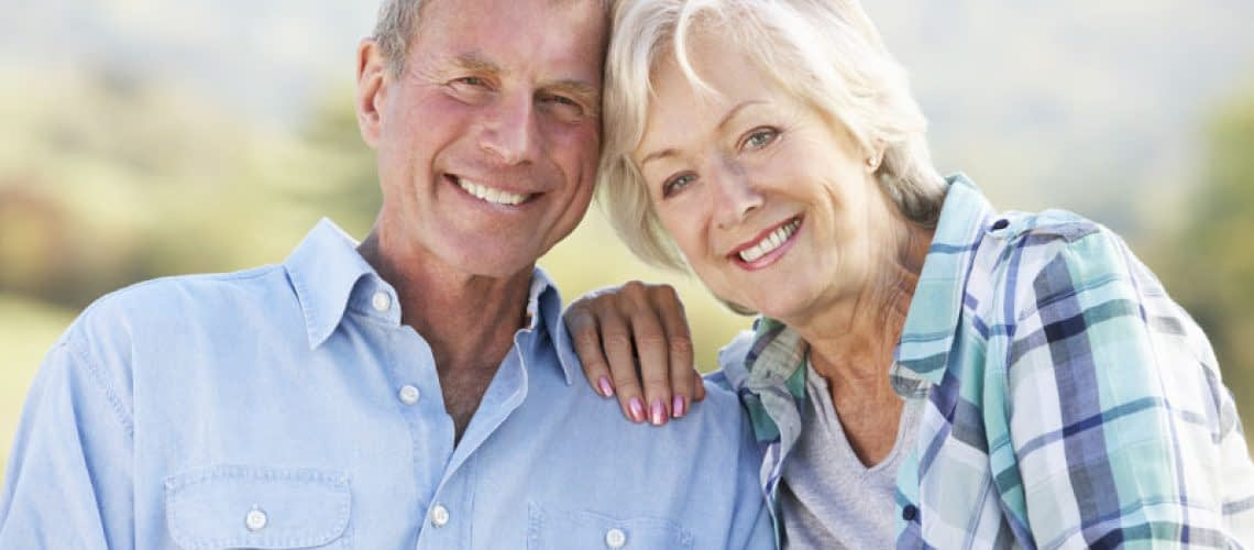 Bone Grafting And Dental Implant Patients Smiling