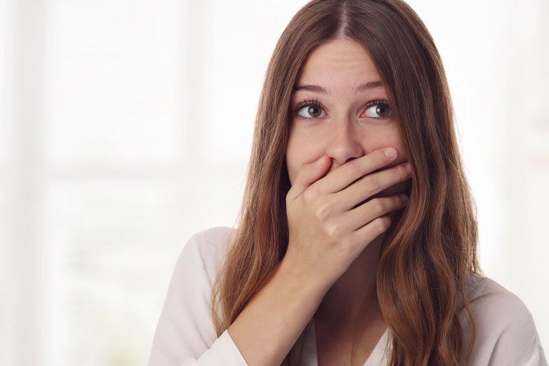 dental patient hiding smile
