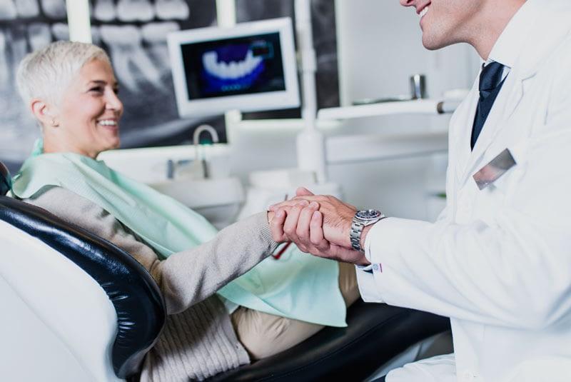 Dental Implant Patient Smiling After Her Procedure