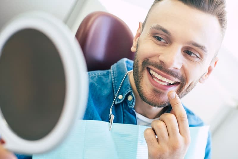 a patient smiling after his professional teeth whitening