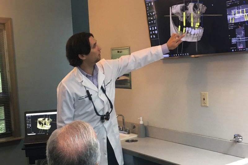 dr-rodriguez-discussing-dental implants placement
