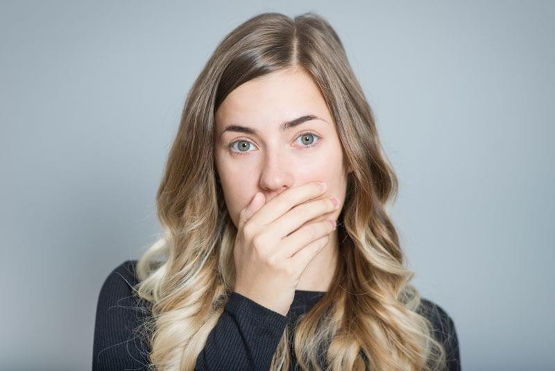 Dental Patient Hiding Her Smile