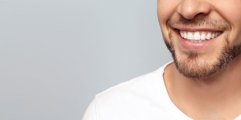patient smiling after complete dental restoration