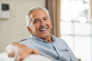 patient smiling after his dental implant procedure