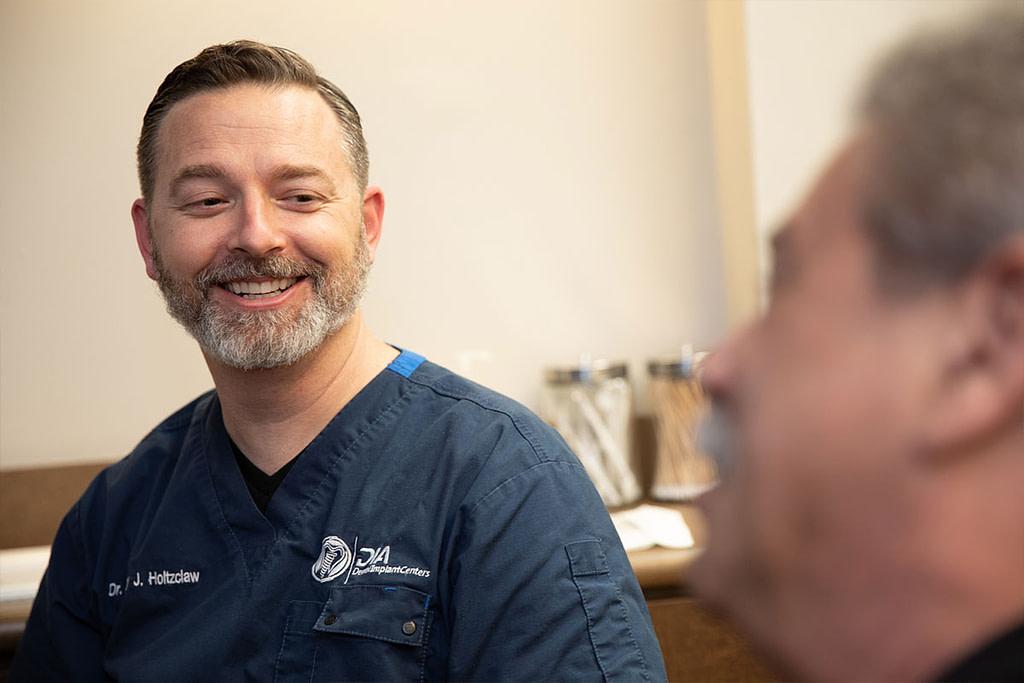 Dr Holtzclaw talking to patient about convenience - Dental Implant Center