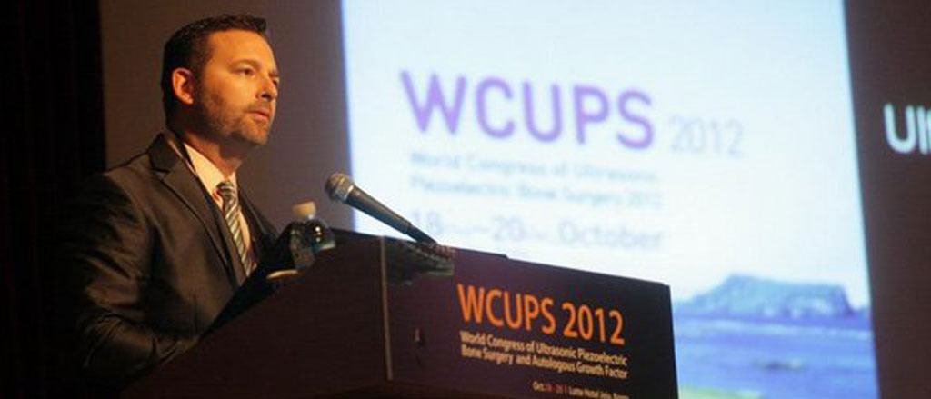 Dr. Dan Holtzclaw speaking at the World Congress of Ultrasonic Piezoelectric Bone Surgery and Autologous Growth Factor 2012