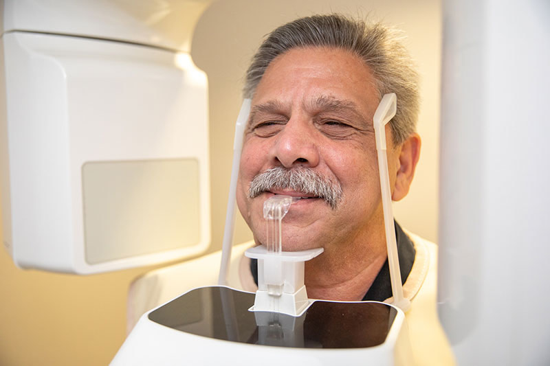 patient being examined by advanced technology - Dental Implant Center