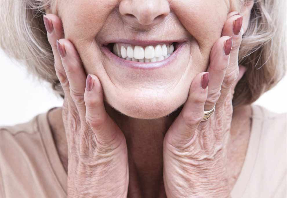 patient smiling with her dental implants