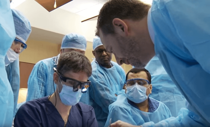 Dr. Holtzclaw training dentists on implant techniques