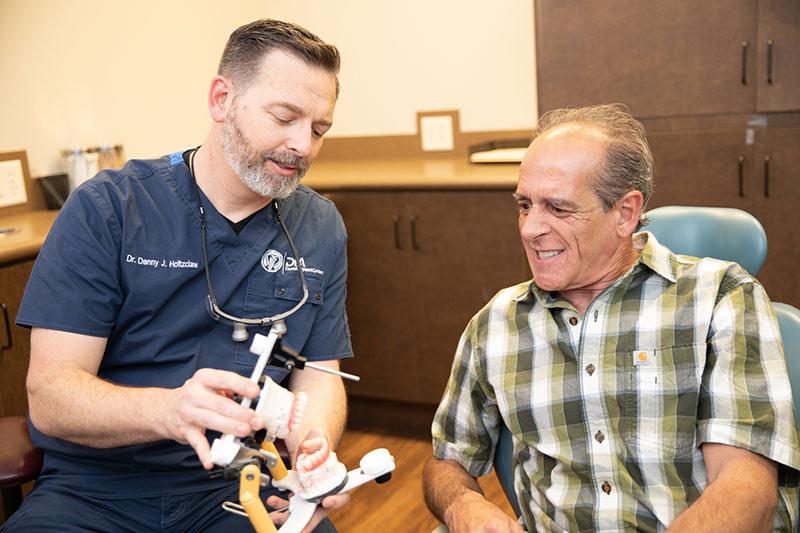 Patient during free dental implant consultation - Dental Implant Center