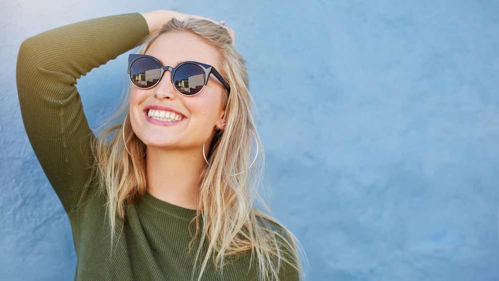 patient smiling after her dental veneer procedure