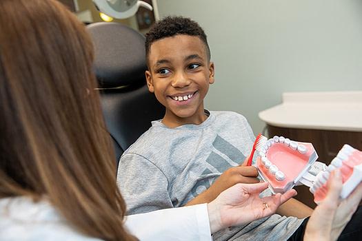 Dr bork with a child patient ALLEN, TX