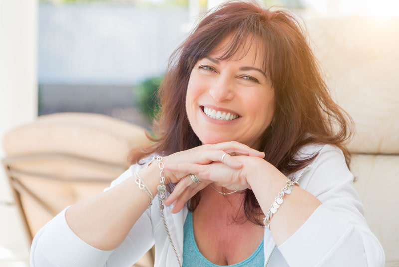 a patient smiling after her Invisalign treatment