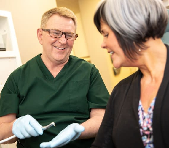 dr connelly discussing dental laser treatment St. Johns, MI