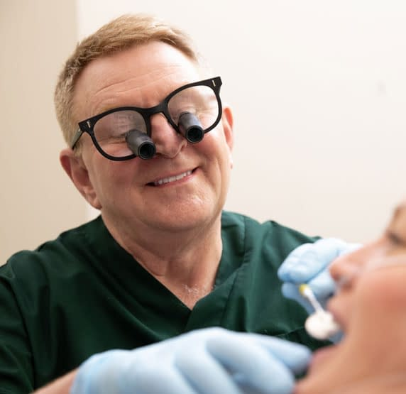 dr connelly performing implant procedure St. Johns, MI
