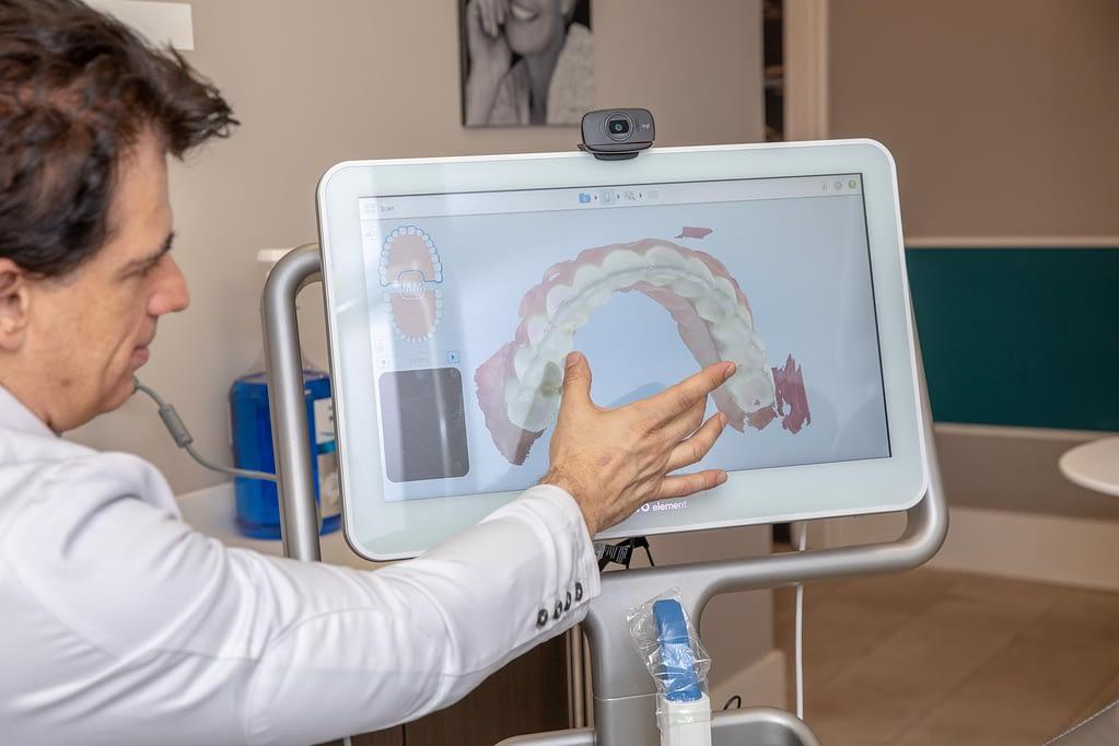 Dr. Trichas consulting a patient MONTCLAIR, NJ