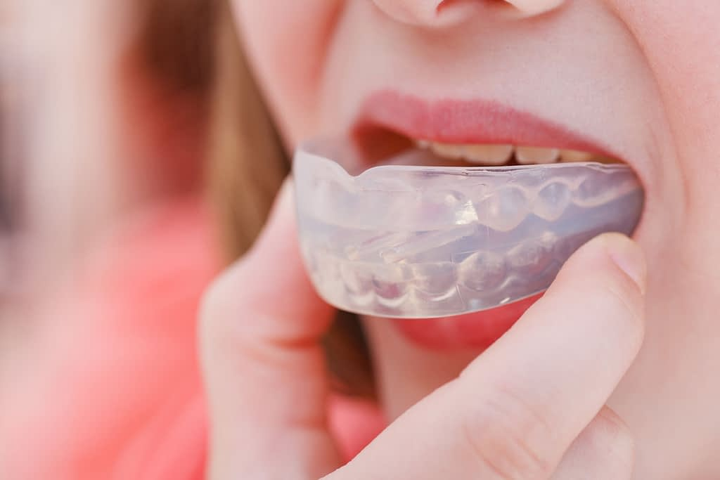 dental patient using mouthguard for tmj treatment Dana Point CA