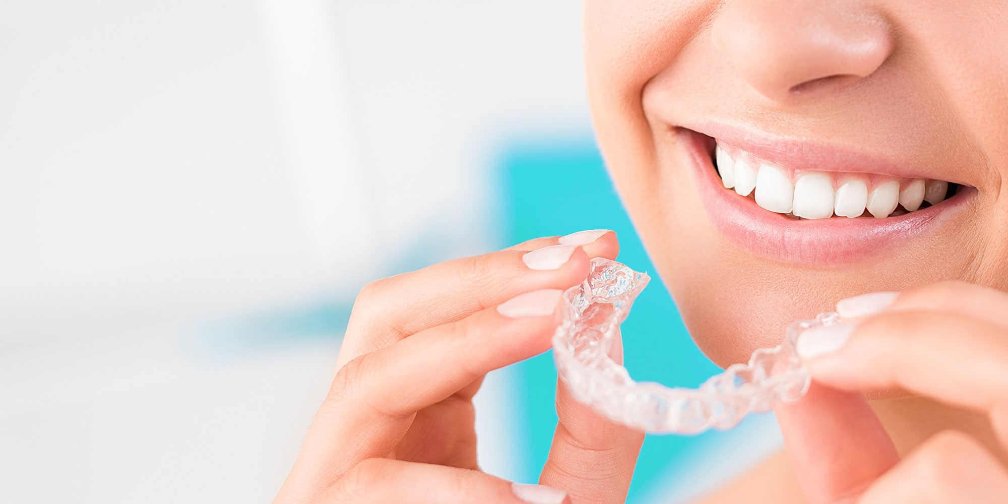dental patient wearing Invisalign Brownstown, MI