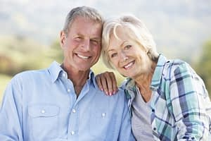 Bone Grafting And Dental Implant Patients Smiling Together