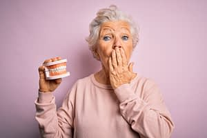 Shocked senior woman with dentures