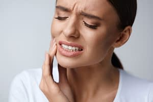Dental Patient In Pain Due To Not Flossing