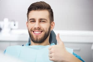 dental patient smiling after gum disease treatment