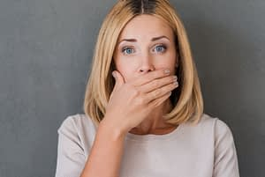 Dental Patient Covering Her Mouth