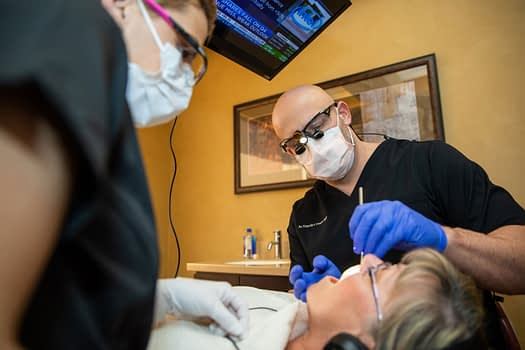 dr pruett performing bone grafting procedure Tavares, FL
