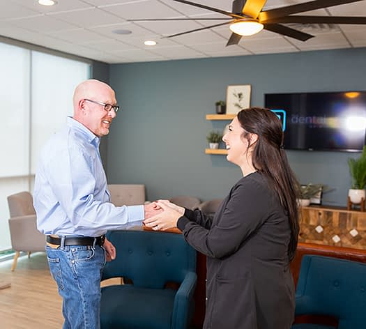 Patient being greeted by staff member at the dental Studio of midland Midland, TX