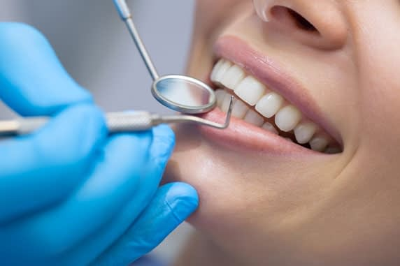 patient undergoing dental procedure St. Johns, MI