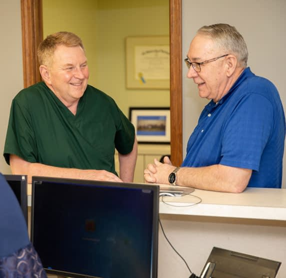 dr connelly discussing dental procedure St. Johns, MI