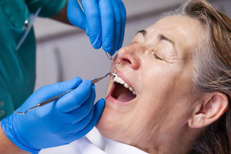 dental patient undergoing periodontal maintenance