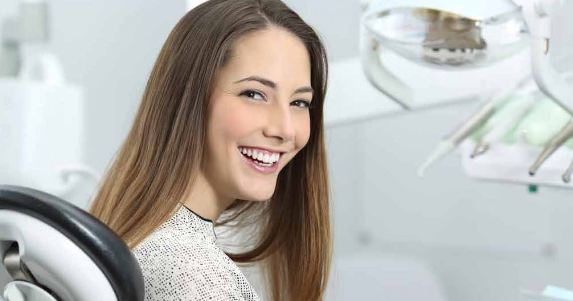 a dental patient smiling after her cosmetic treatment