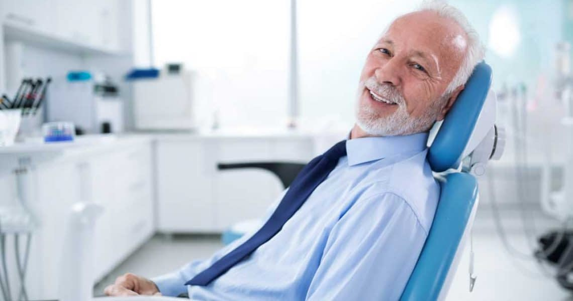 patient smiling after his sedation dentistry