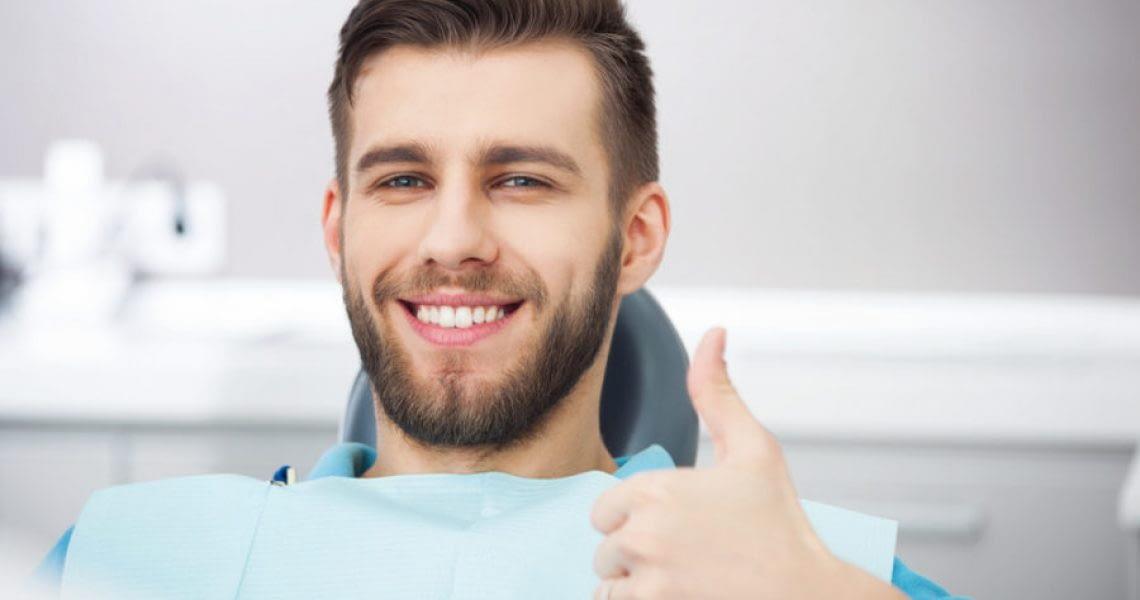 dental patient smiling after gum disease treatment